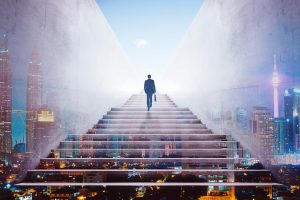 graphicstock rear view of a businessman climbing stairs to get to a large city center concept of success and appreciation double exposure HdIPxnwejx